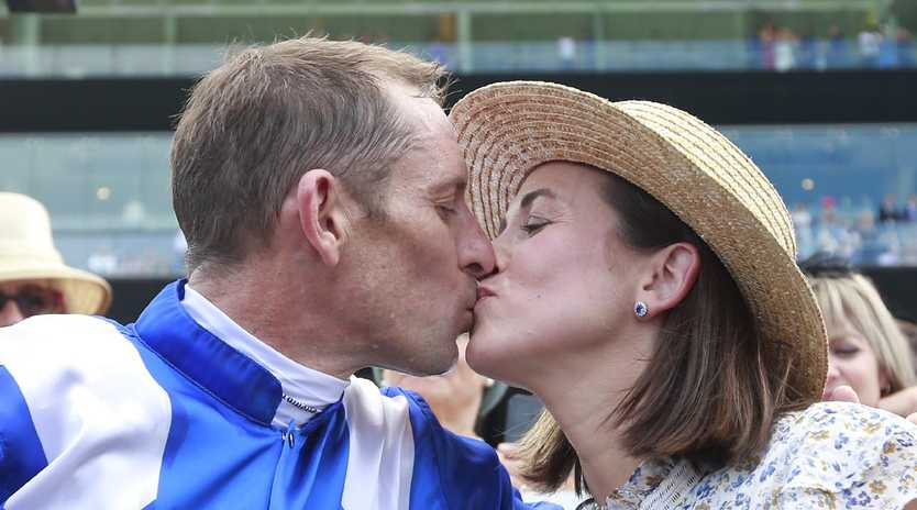 Hugh Bowman kisses wife Christine after winning the Chipping Norton Stakes on Winx last Saturday. Picture: Getty Images