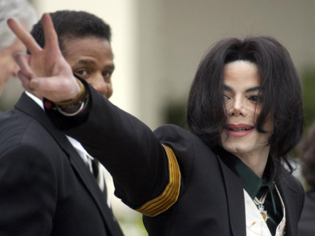 Michael Jackson waves to his supporters as he arrives for his child molestation trial at the Santa Barbara County Superior Court in 2005. Picture: AP