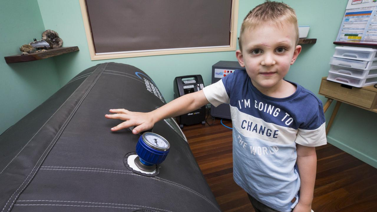 Eli Campbell with his portable hyperbaric chamber he uses as part of his ongoing treatment after suffering a near fatal snakebite at Agnes Waters. Picture: Lachie Millard