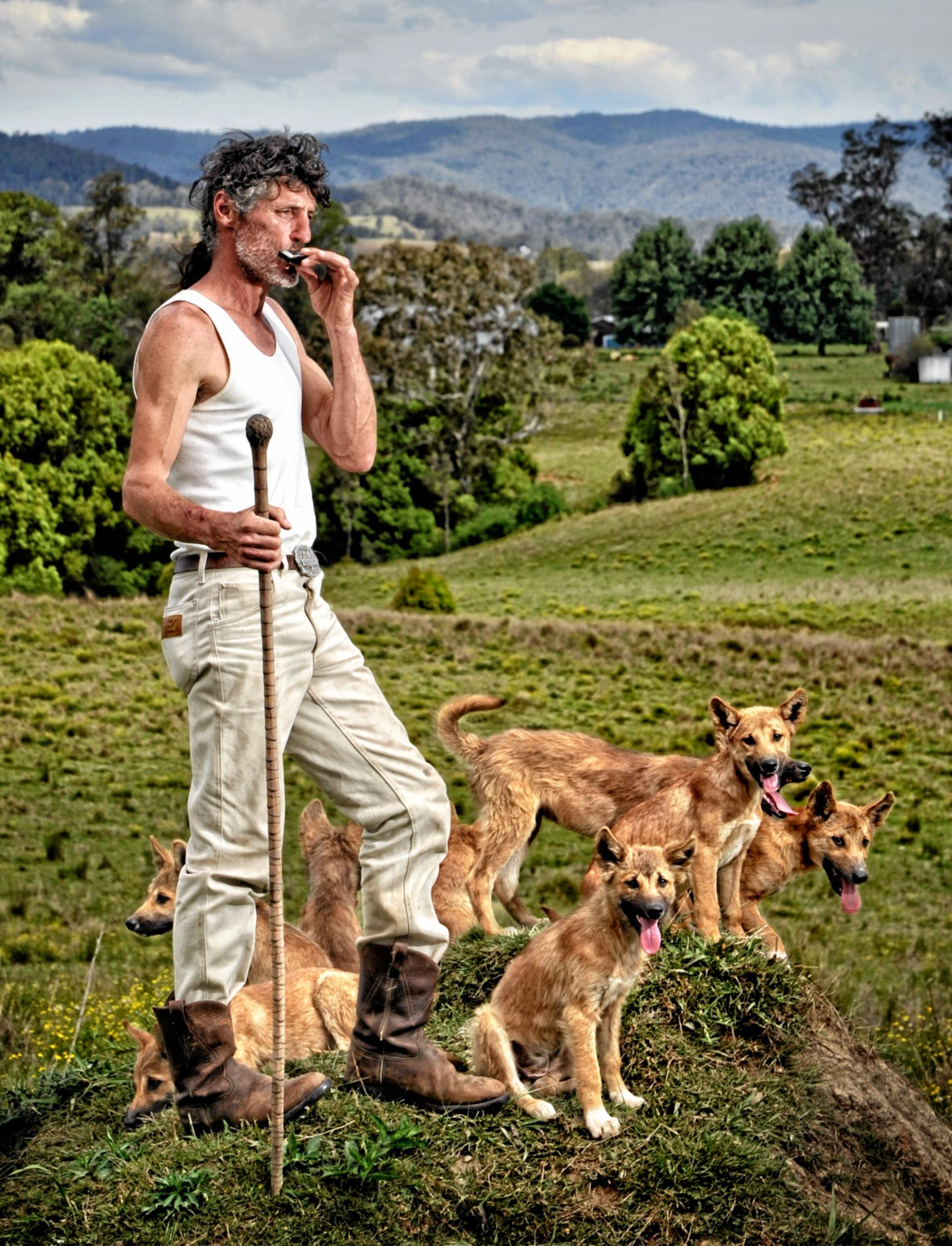 INTO THE WILD: John Cooper on his Nymboida property with his dingo clan.