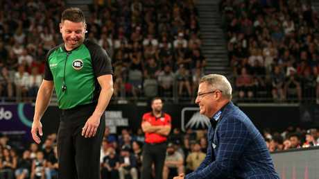 Referee Michael Aylen shares a joke with melbourne coach Dean Vickerman. Pic: AAP