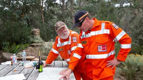Police and SES crews scour rugged terrain in Mount Buffalo as they search for missing Melbourne couple, Trevor Salvado and Jacinta Bohan. SES, Deputy Commander, Graham Gales (Bright) and Andy Carr (Beechworth SES) take a look at map of the search area at the search and rescue base.. Picture: Sarah Matray