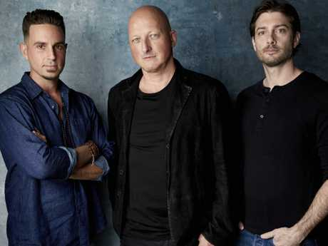 Wade Robson, from left, director Dan Reed and James Safechuck pose for a portrait to promote the film Leaving Neverland. Picture: AP
