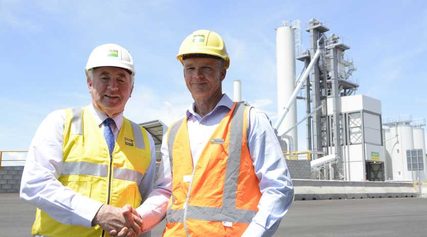 NOW OPEN: Toowoomba Mayor Paul Antonio congratulates Boral's Queensland executive general manager Simon Jeffrey after the company launched its new asphalt plant in Wellcamp this week.