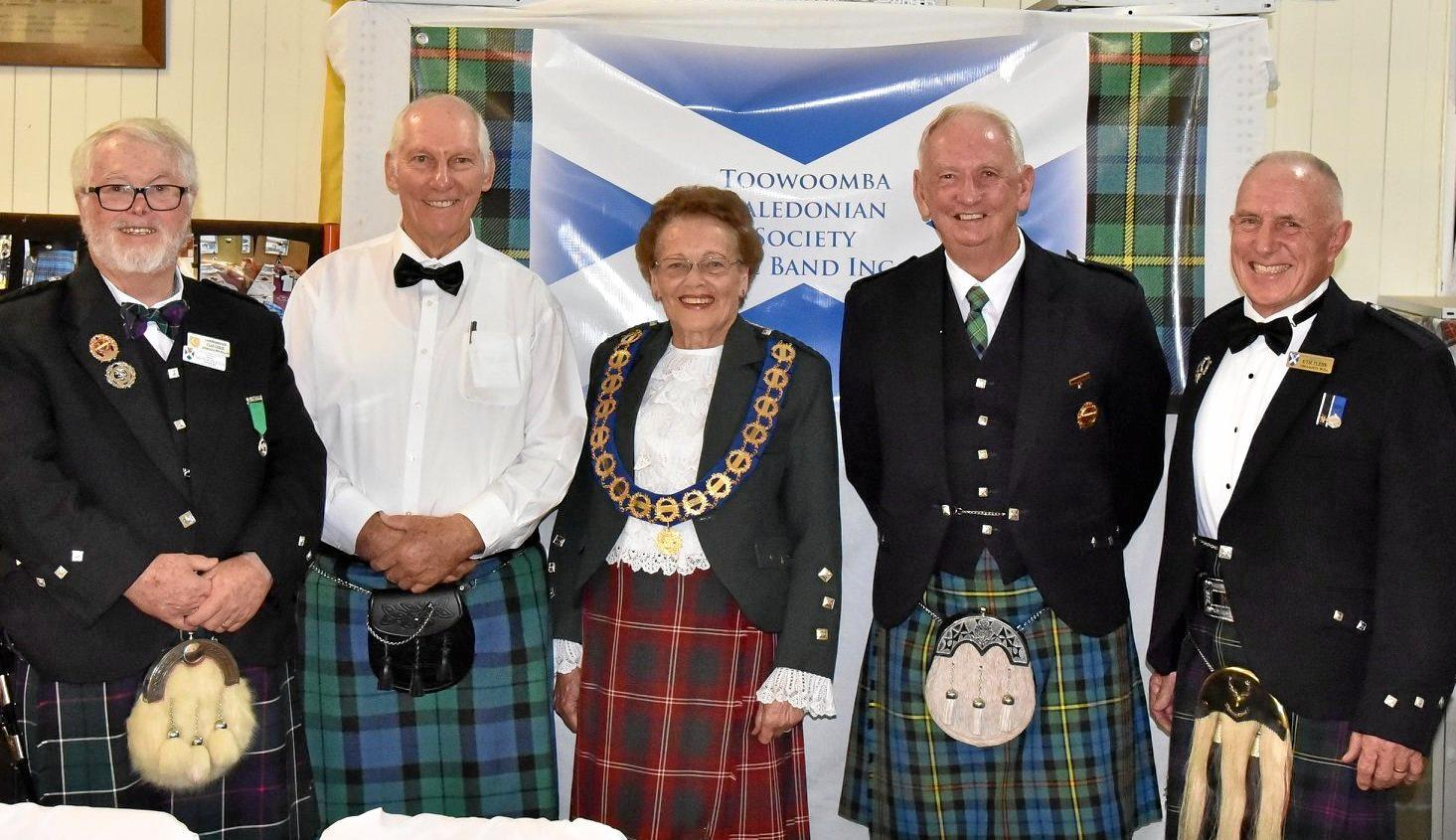 KEEPING UP TRADITIONS: Past chieftain Mal Lesley, president Col McKay, first female chieftain Irene Batzloff, patron Carl Hinds and past chieftan Kym Flehr at the recent Toowoomba Caledonian Society and Pipe Band's Burns Supper, celebrating poet Robert Burns.