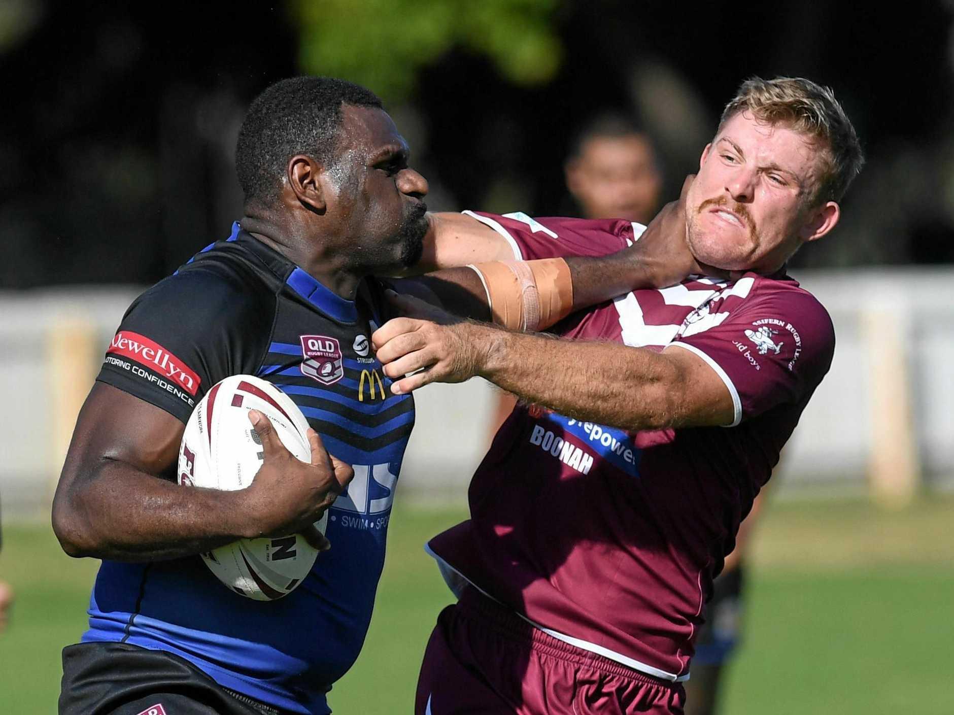 Raymond Baira gives Alex Ross a stiff arm to the throat in the Goodna, Fassifern RLI clash at Woogaroo Field.