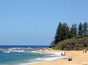 One hospitalised after near drowning at Coast beach