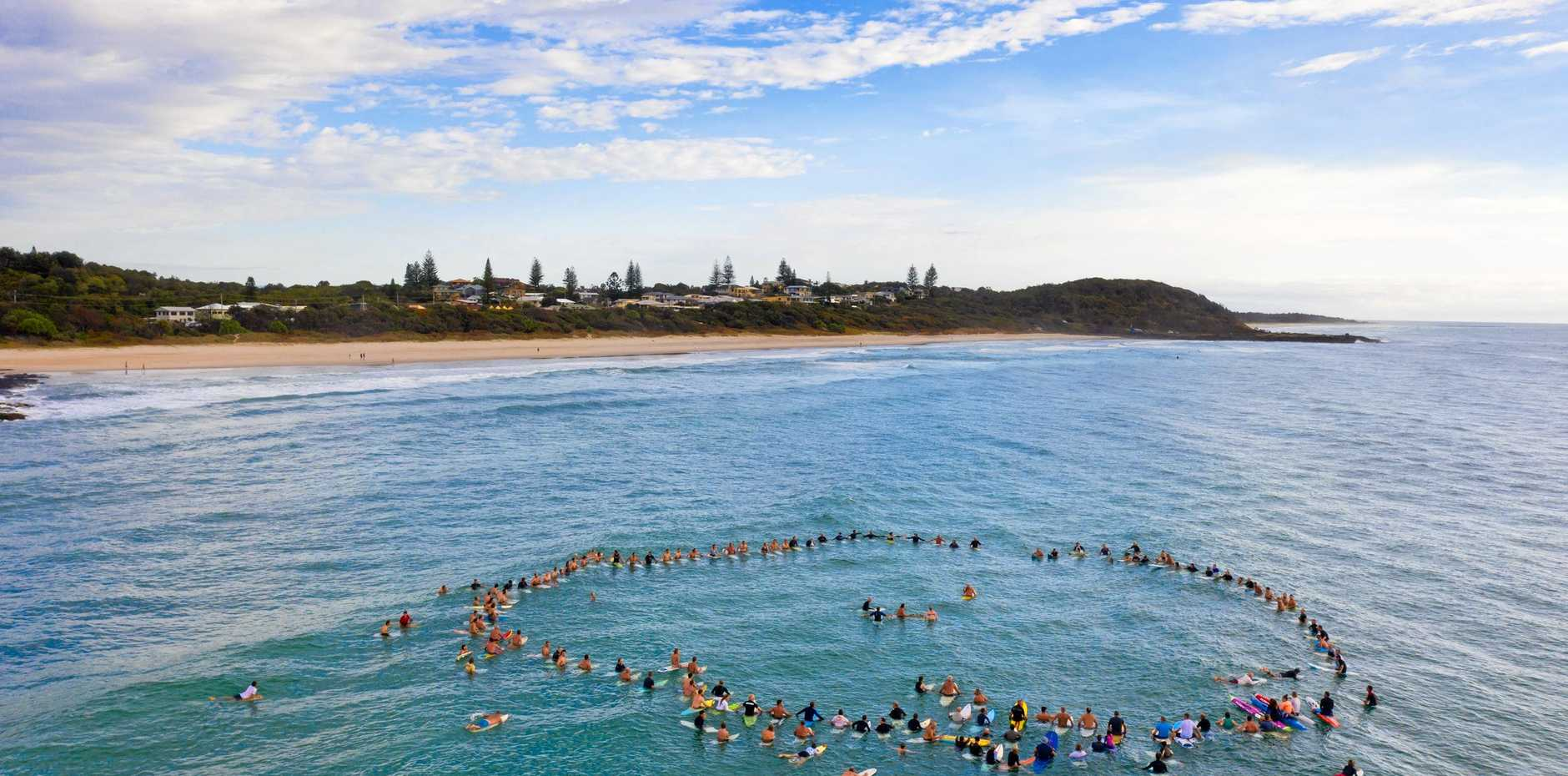 A paddle out was held in memory of well respected community member Raz Burtonwood who went missing in ocean last month.