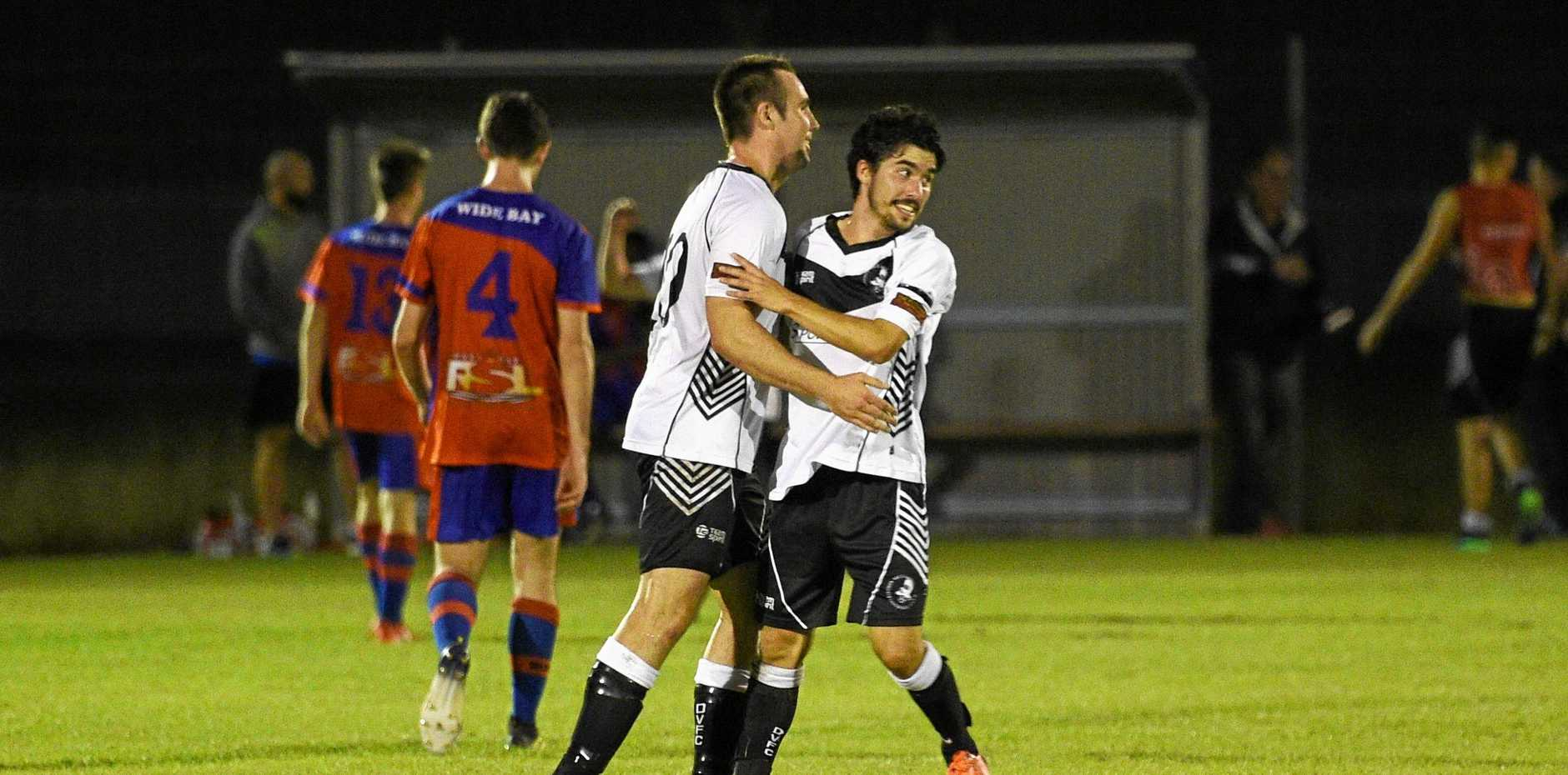 Doon Villa players celebrate after their 2-1 FFA Cup win against Wide Bay Buccaneers at Villa Park, Maryborough.
