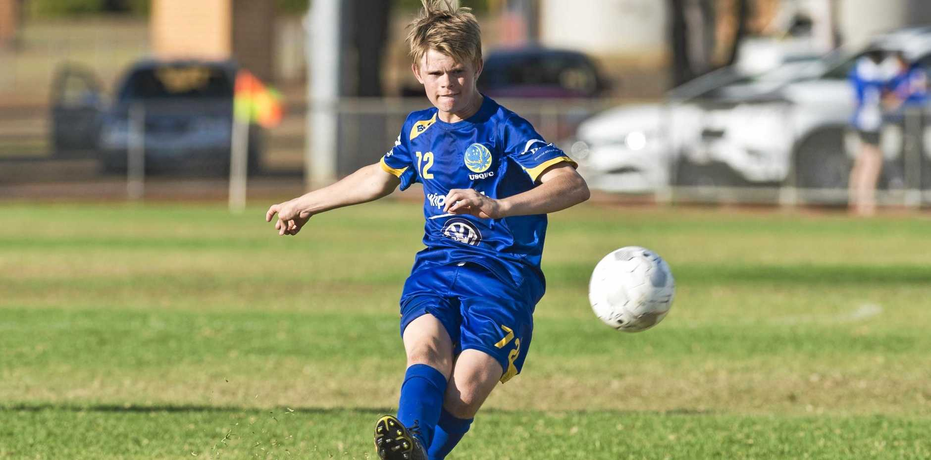 GOOD STRIKE: Striker Dylan Proctor puts one on target during his side's Toowoomba Football League premier men's game against Rockville. The 15-year-old USQ striker scored a hat-trick in the team's 5-1 win.