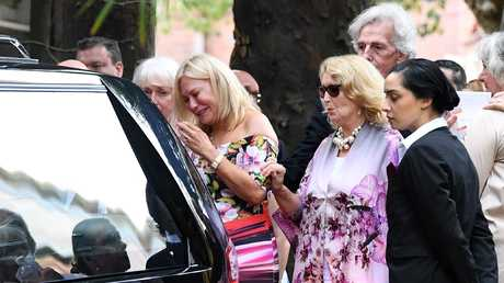 The TV personality was comforted by attendees. Picture: AAP Image/Joel Carrett