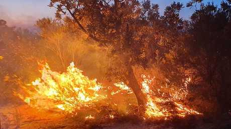 The fire burns at Woodgate near Bundaberg. Picture: Woodgate Rural Fire Brigade