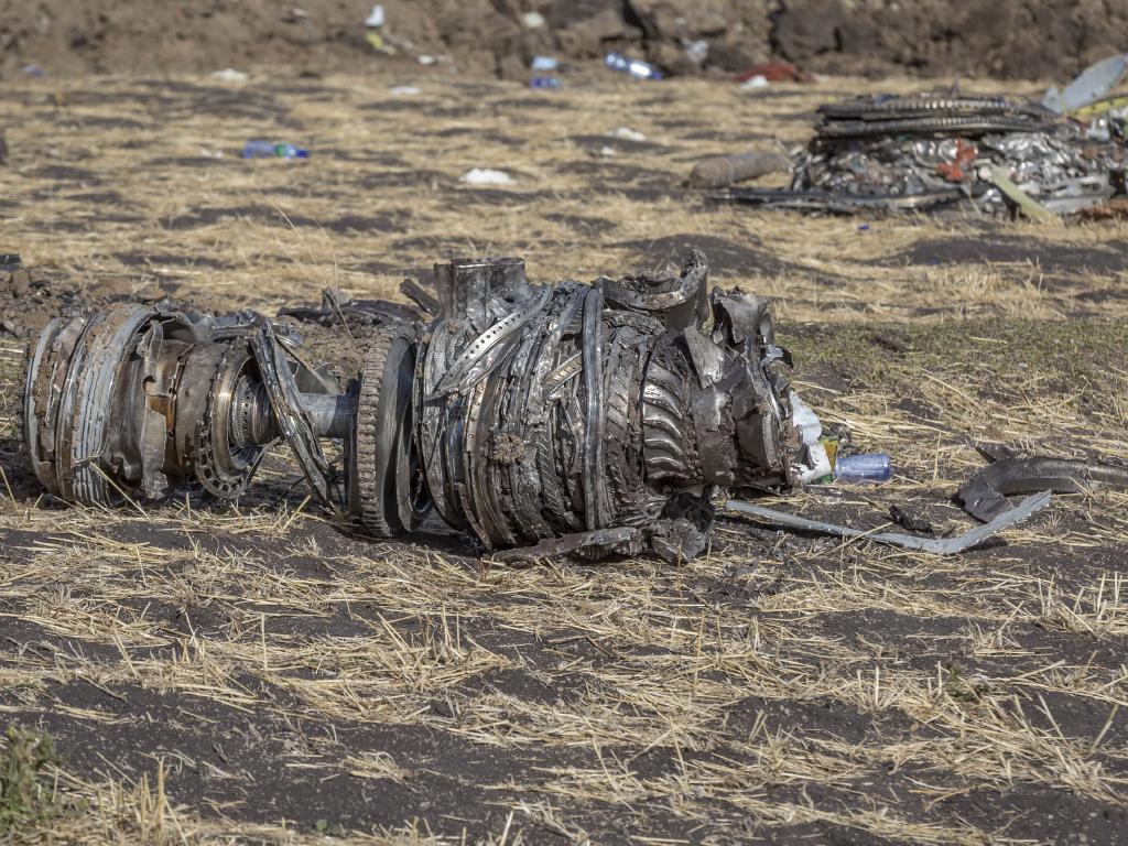 Airplane parts lie on the ground at the scene of an Ethiopian Airlines flight crash near Bishoftu.