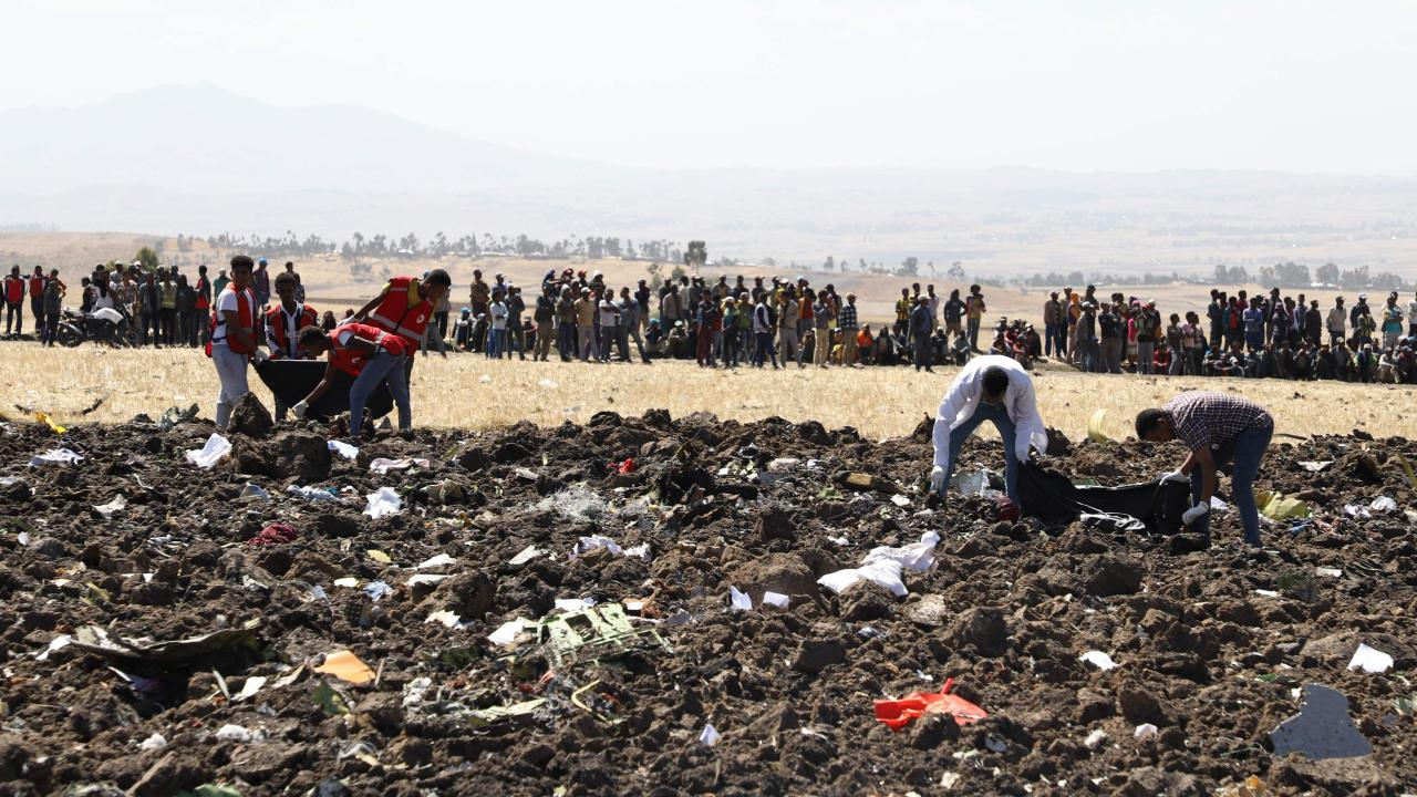 Rescue team collect remains of bodies amid debris at the crash site of Ethiopia Airlines, southeast of Addis Ababa, Ethiopia, on March 10, 2019. Photo AFP