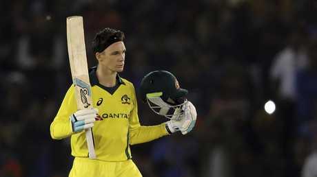 Peter Handscomb raises his bat to celebrate scoring a century. Picture: AP