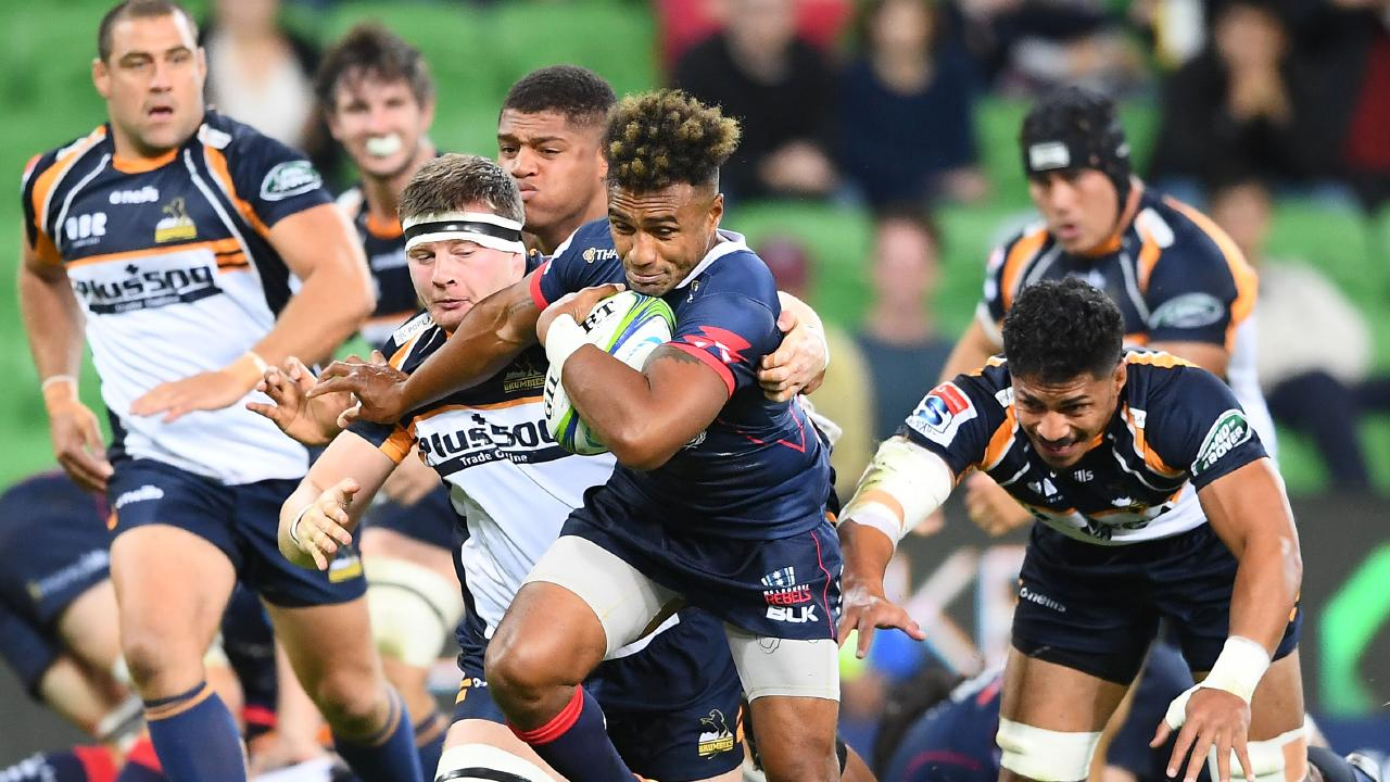Will Genia of the Rebels breaks free of a tackle during the round four Super Rugby match between the Rebels and the Brumbies at AAMI Park. Picture: Getty Images