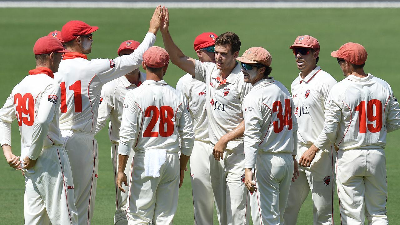 South Australian paceman Nick Winter (centre) celebrates Queensland batsman Matt Renshaw's dismissal at the Gabba. Picture: AAP Image/Dave Hunt.