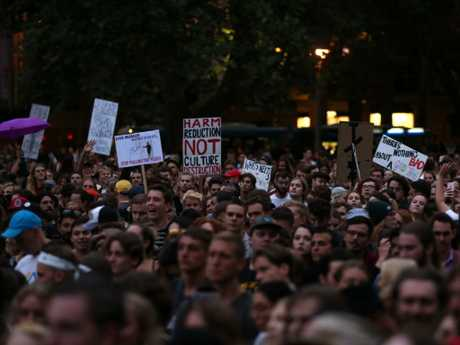 Protesters hold signs during the Don't Kill Live Music Rally in Sydney last month.