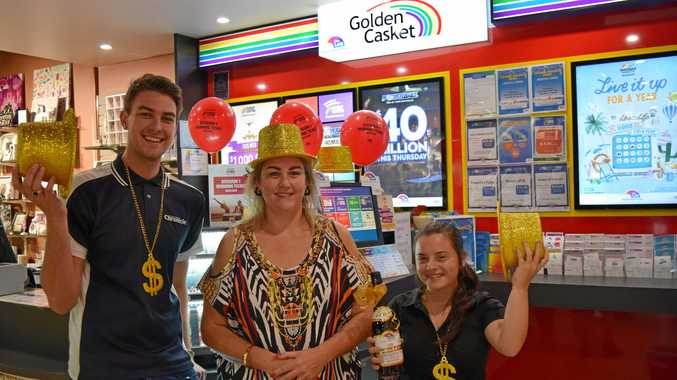 LUCKY DAY: Pandora News manager Becky Bull with Jordan Ruge and Arabelle Solly (right) will be celebrating for some time after a customer won more than half a million in a Lotto draw.