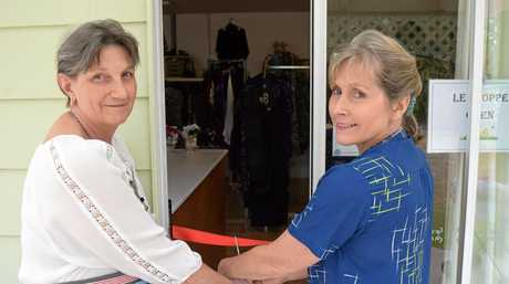 Fair Haven Aged Care Service lifestyle team leader Juliet Henderson (right) with Fair Haven lifestyle and activities volunteer Merise Bates cut the ribbon to the reopening of Le Shoppe.