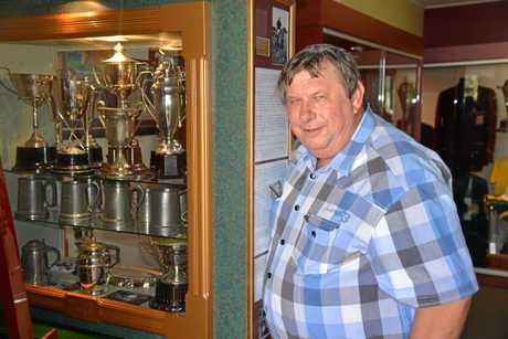 TROPHIES GALORE: Allora Sports Museum organiser Perry Cronin near the entrance to the museum.