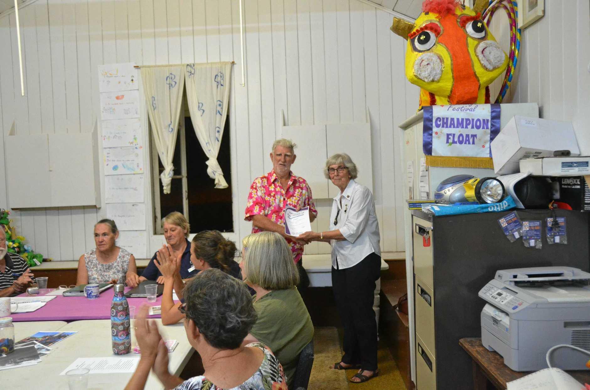John Stott accepts a certification of appreciation at Gayndah Girl Guides 2019 AGM.