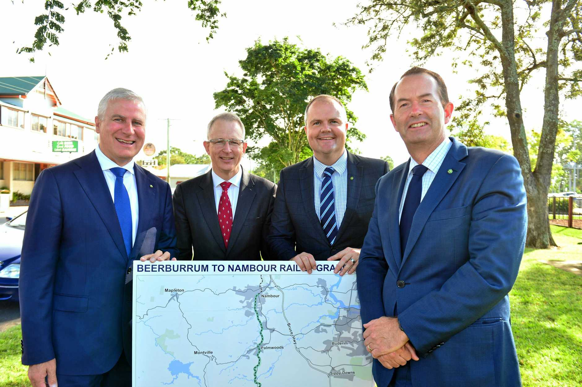Deputy Prime Minister Michael McCormack, Minister for Urban Infrastructure Paul Fletcher,   Member for Fairfax Ted O'Brien and Member for Fisher Andrew Wallace  at Landsborough to announce $390 million for the rail line from Sunshine Coast to Brisbane.