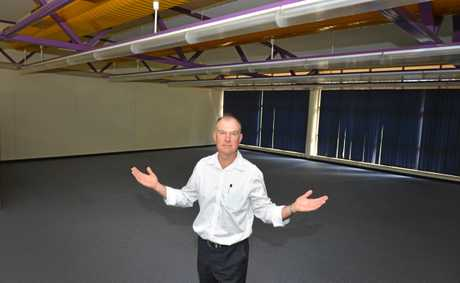 Tony Perrett standing in the unused TAFE building during his crusade to secure it for the USC Gympie facility.