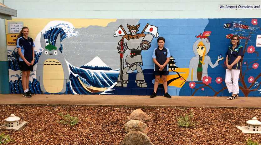 CULTURE: Former Kingaroy State School students Isabella Appeldorn and Kalan Amy return to the school to see the Japanese mural and garden area with teacher Mrs Danielle Carige.