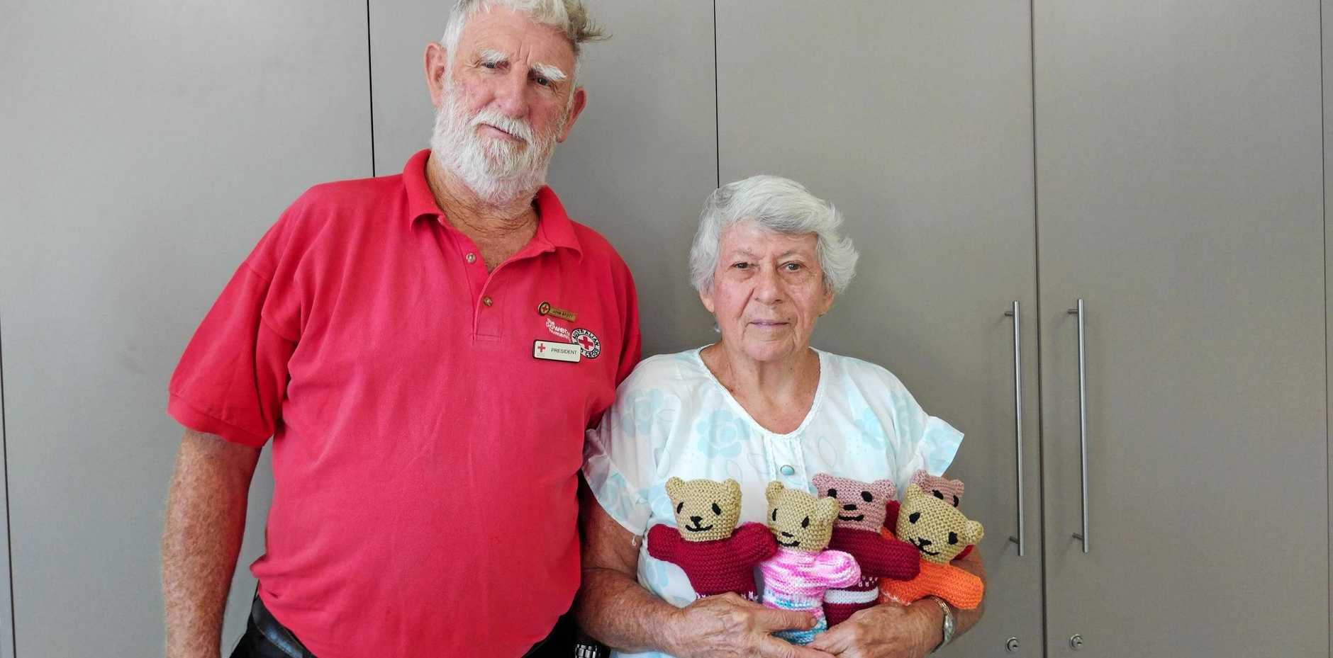 NEEDLE WORK: Red Cross Gayndah branch president John Stott with Pam Boughen and some Trauma Teddies.