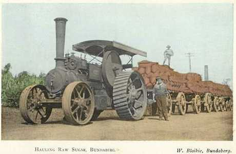 SUGAR INDUSTRY: A steam engine with wagons loaded with bags of sugar in Bundaberg around 1914.