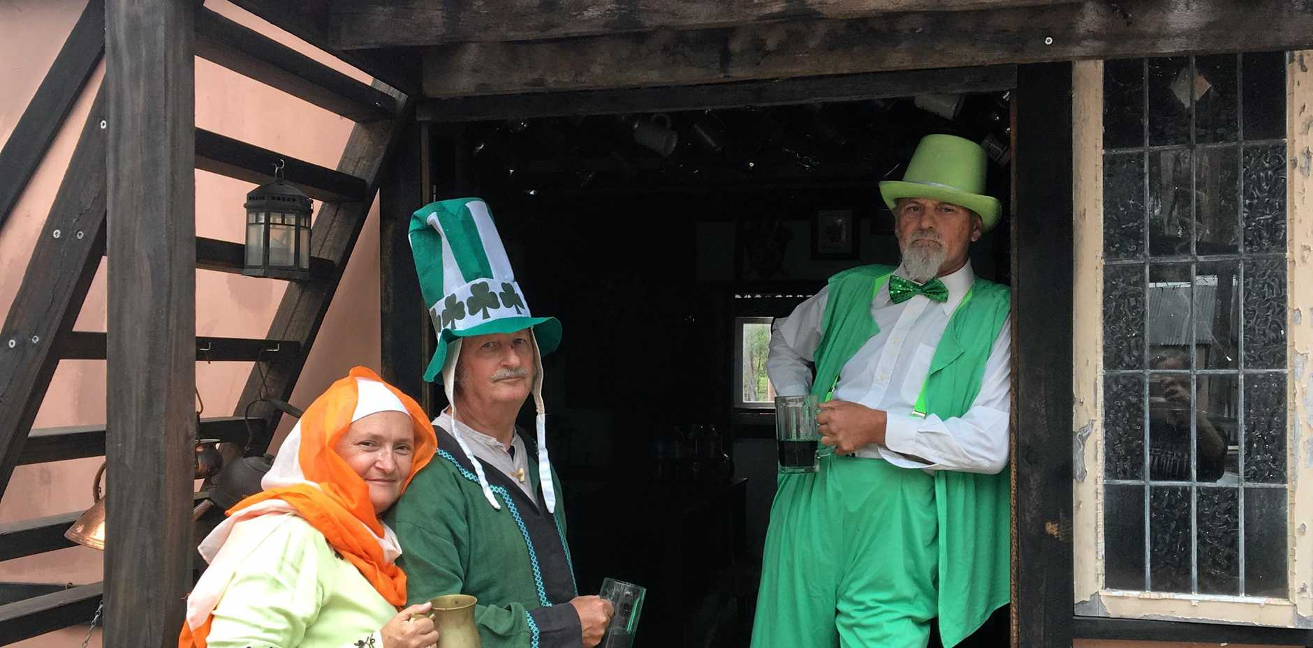 IT'S EASY BEING GREEN: Lady Jennifer and husband Lord Minstrel Steve Bryson with Lord Terence Blake invite you to celebrate St Patrick's Day with fun, laughter, medieval merriment and green beer at Victory Village.
