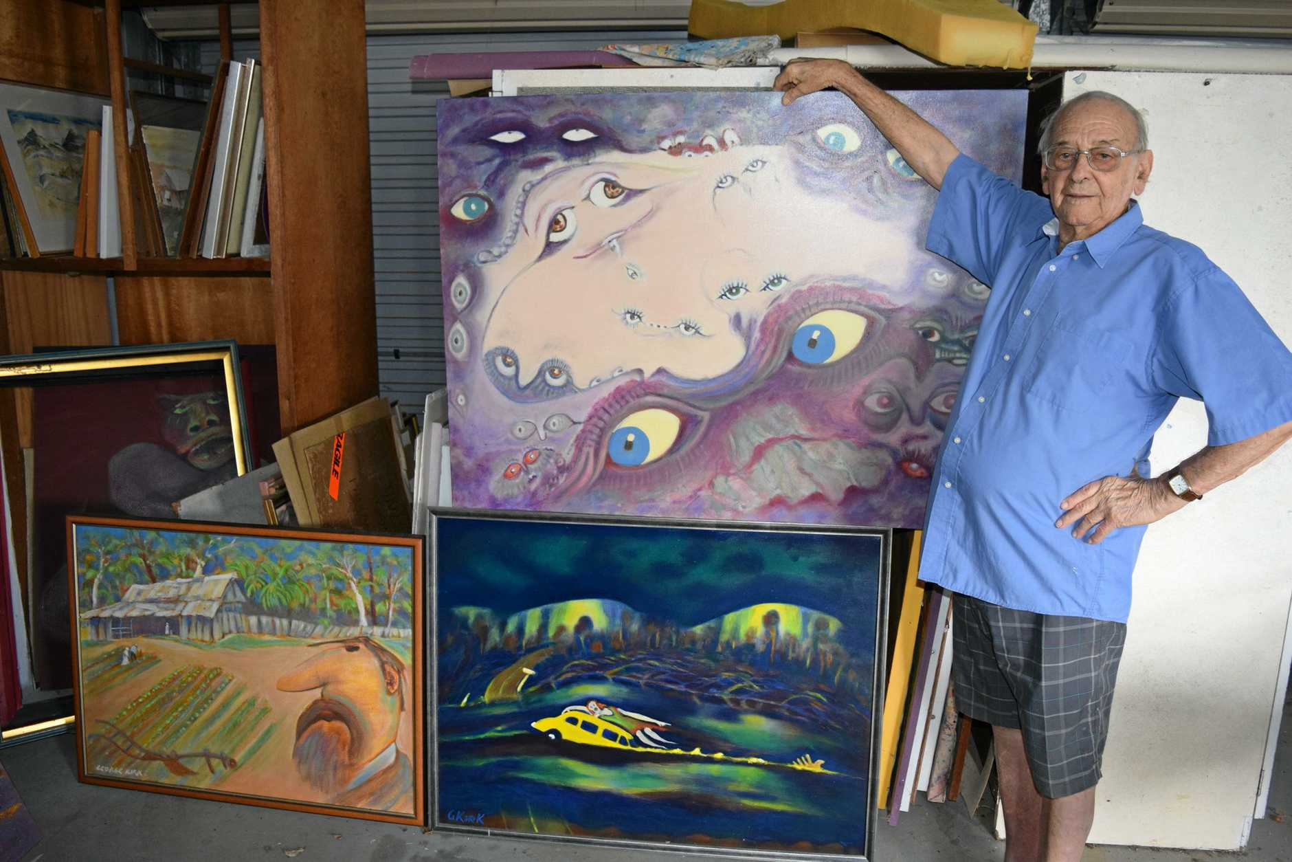 VIBRANT COLOURS: Maryborough artist George Kirk with some of his artworks (clockwise from left) Land of our Fathers, Windows of Perception and Deep Creek.