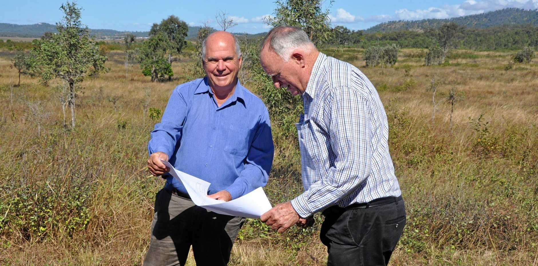 CLEAR PLAN: Mayor Bill Ludwig and Cr Tom Wyatt examine plans for the new memorial gardens at the Taroomball site.