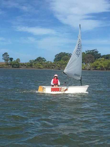 Sarah Scantlebury sailing her Optimist on the Burnett River