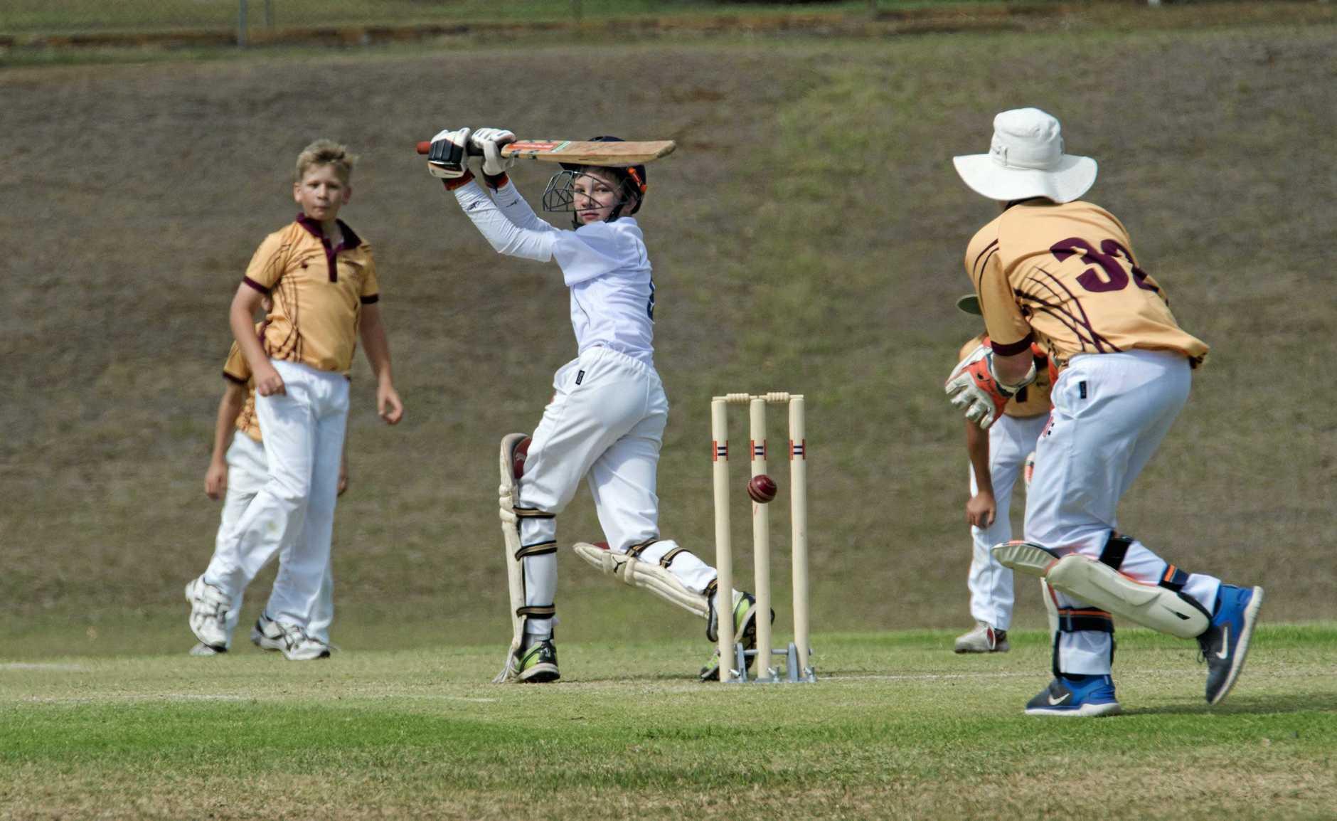 Norths batsmen Sam Burke plays one behind the stumps.