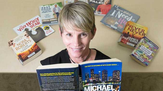 SPOILED FOR CHOICE: Mackay Regional Council Libraries' community outreach team leader Kimberly Lehto-Head with some  popular books borrowed.