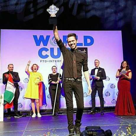 WINNERS ARE GRINNERS: Bundaberg's Bart Hassam has claimed first place at the Florist World Cup in Philadelphia.