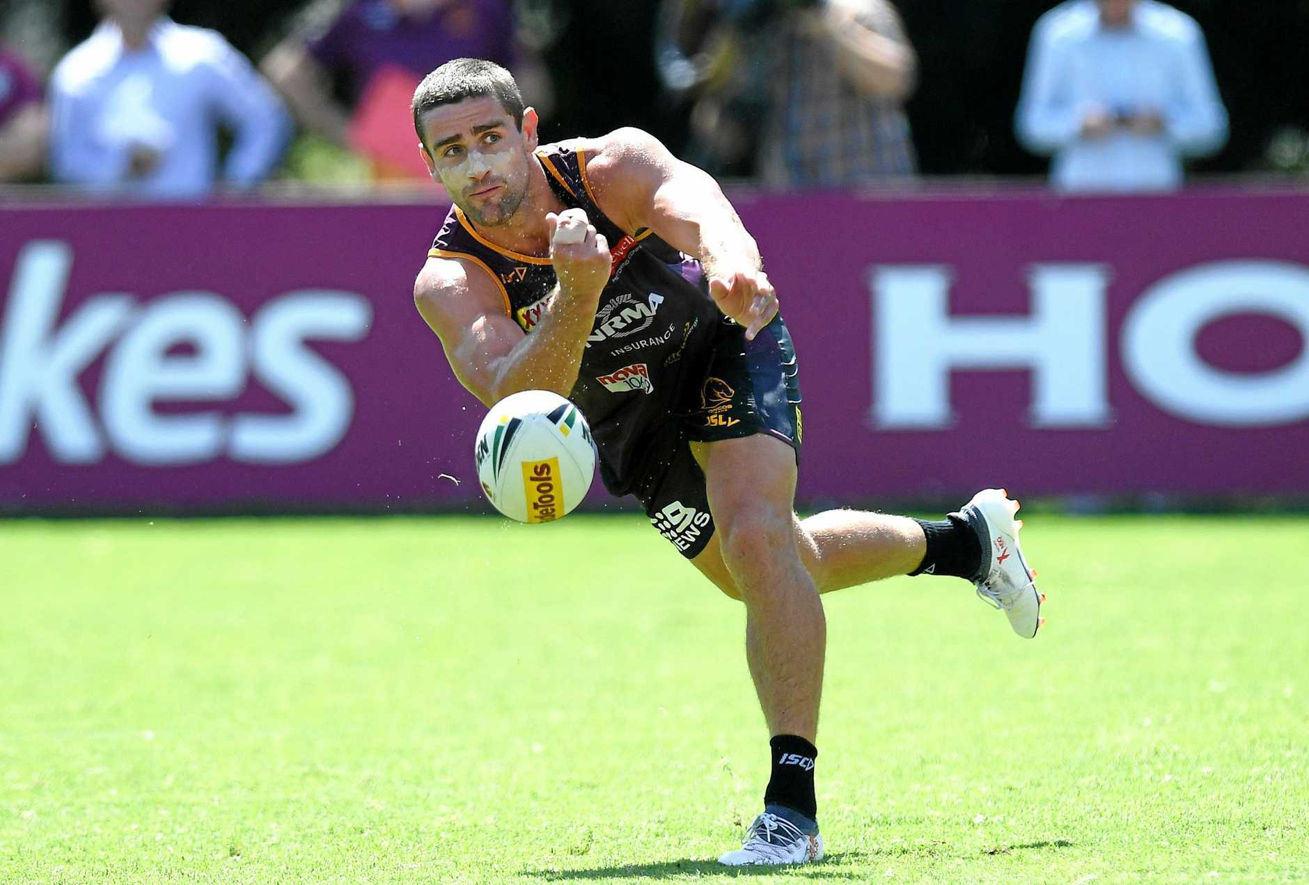 BRISBANE, AUSTRALIA - FEBRUARY 12: Andrew McCullough passes the ball during a Brisbane Broncos NRL training session at Red Hill on February 12, 2019 in Brisbane, Australia. (Photo by Bradley Kanaris/Getty Images)