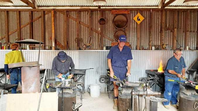Participants get into the blacksmith workshop.