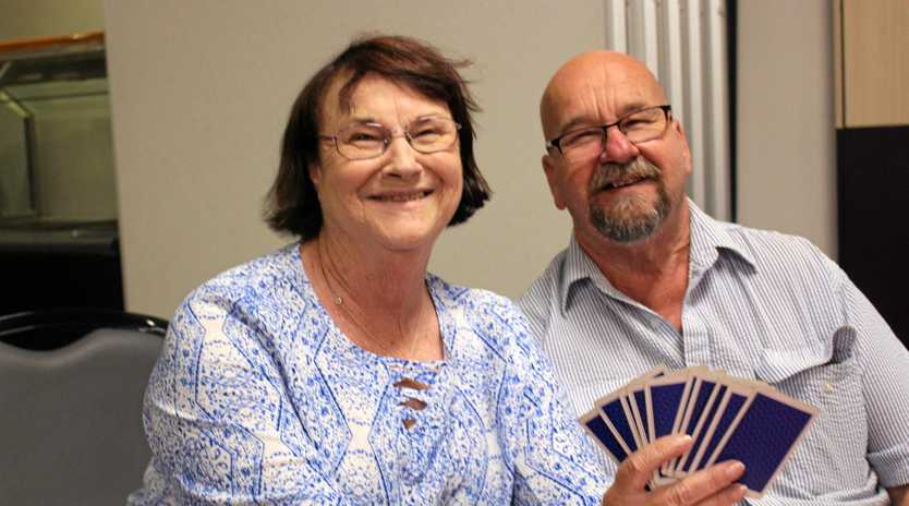 DEAL: Carol Verwey and Bob Adams enjoy a game of 500 at the Stanthorpe RSL.
