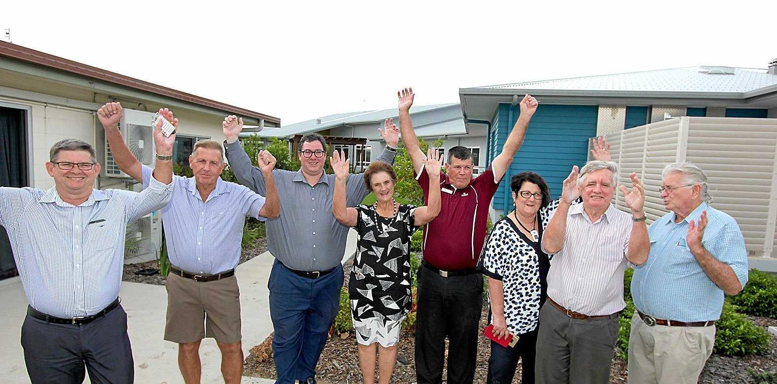 STOKED: Murroona Gardens residents are jumping for joy following the approval of 14 new residential aged care places. Pictured are Murroona Gardens CEO Greg Pollard, Gary Martin, Dawson MP George Christensen, Ruth Morton, Ross Meyer, director of nursing Megan Murray, Kevin Baxter, Adrian Tilney and Michael Reinke.