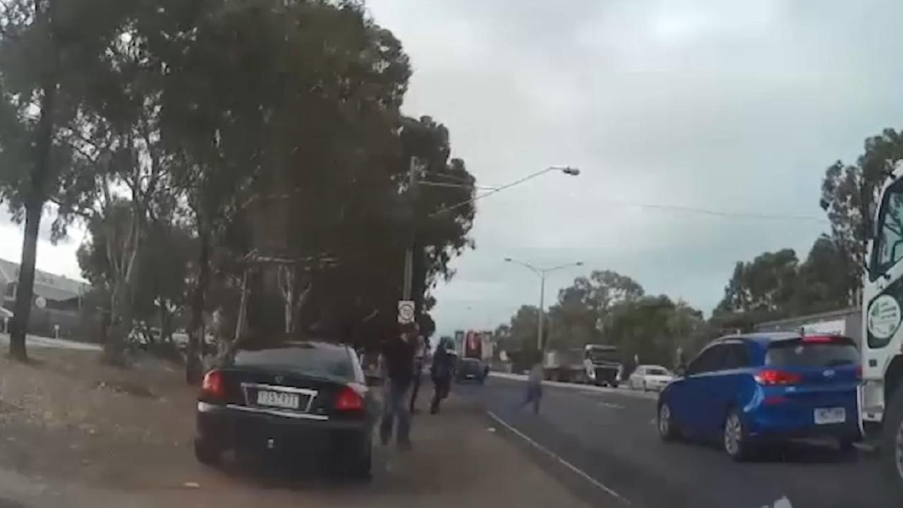 A driver jumps out of his car to help. Picture: The Age
