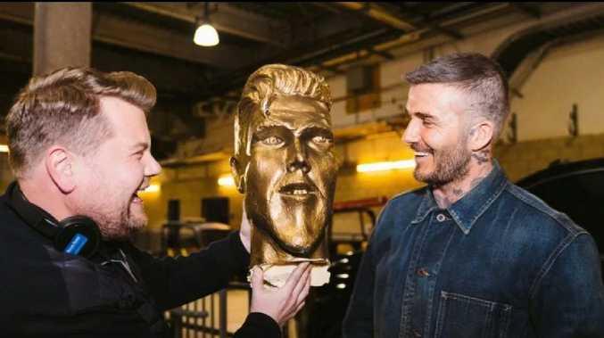 James Corden and David Beckham share a laugh.