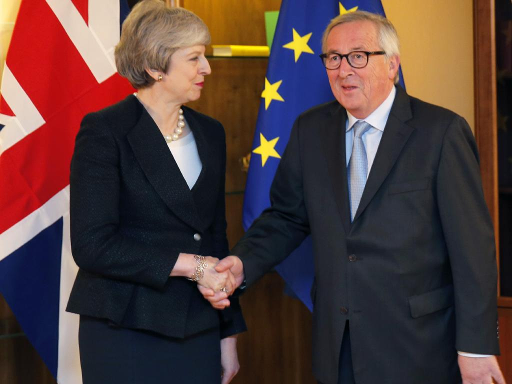 British Prime Minister Theresa May poses for the media with European Commission President Jean-Claude Juncker in Strasbourg.