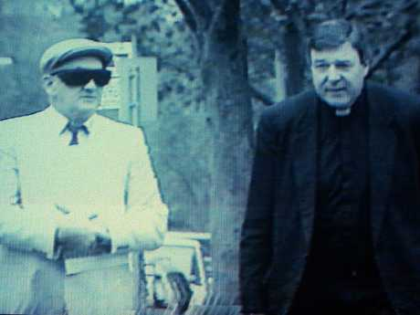 Pell walked said he was offering support when he walked alongside convicted paedophile priest Gerald Risdale. Picture: Channel 9