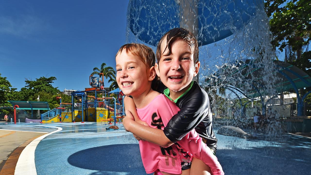 Siblings Isobella, 7, and Michael Porter, 6, of Aitkenvale enjoy The Strand water park ahead of forecast storm activity. Picture: Zak Simmonds