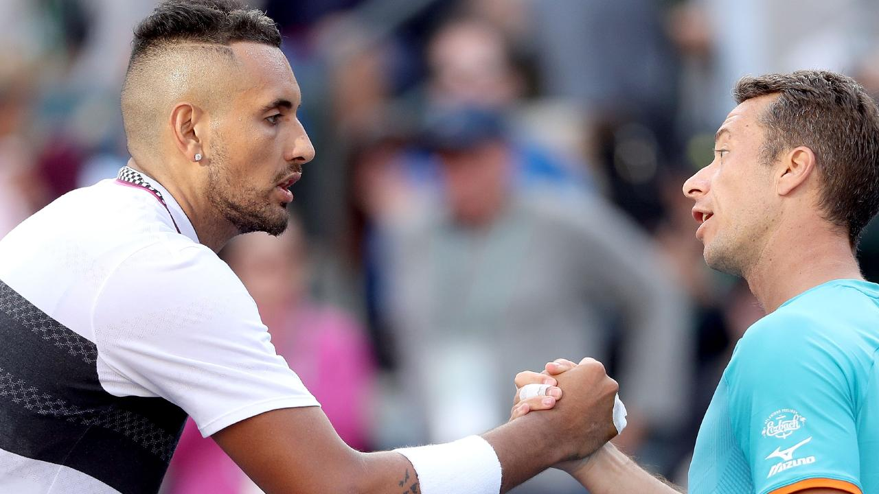 Nick Kyrgios congratulates Philipp Kohlschreiber after their match at Indian Wells. (Photo by Matthew Stockman/Getty Images)