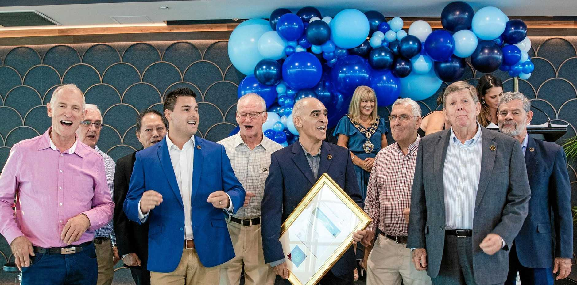 SONG IN THEIR HEARTS: Senior members of The Blenders chorus, headed by president Damon Newman, are urged into song as they accept the Gold Coast City Council Community Service Award.