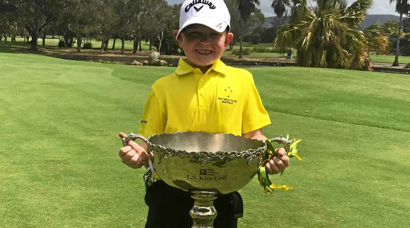 Rockhampton's Eli Parsons proudly displays the US Kids Golf Trans-Tasman Cup, which he and his Australian teammates won on the Gold Coast.